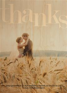 Couple hugging in a field on a Custom Real Wood Photo Card