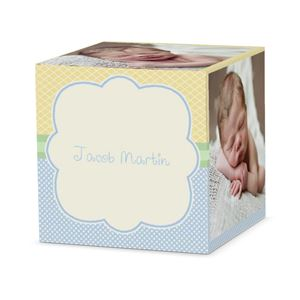 Sleeping baby boy on a custom tickled blue cube