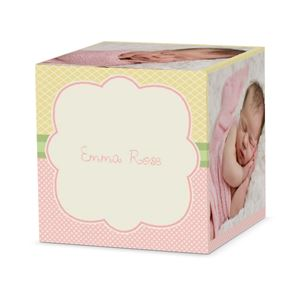 Sleeping baby girl on a custom tickled pink cube