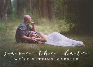 Couple laying in the woods on a Custom Save The Date Photo Card