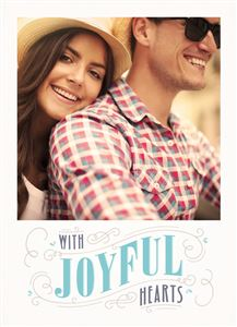 Smiling couple with matching hats on a Joyful Hearts Invitation Card